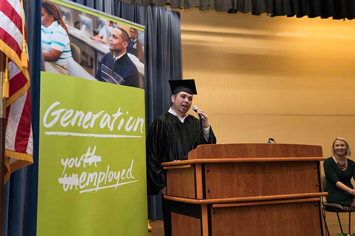 Speaker and Generation student Brandon Mead, Jacksonville, addresses an audience of families and graduates on Friday, Sept. 29 on Florida State College's downtown Jacksonville campus.