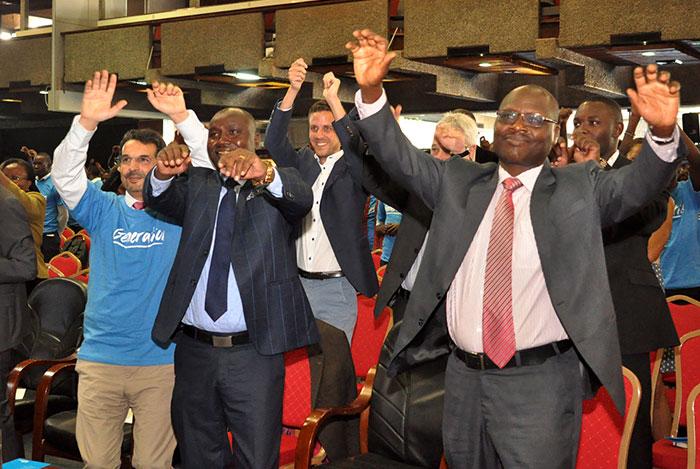 Generation Kenya's Mehdi Sinaceur celebrates with Dr. Kipkirui Langat, Director General/CEO for the TVET Authority (TVETA), and Paul Kosgei, Director General for National Industrial Training Authority (NITA)